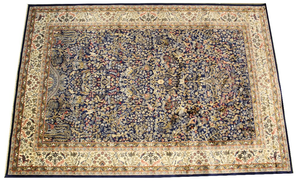 A rich blue ground Kashmir, all over tree-of-life design, surrounded by a cream border with animal