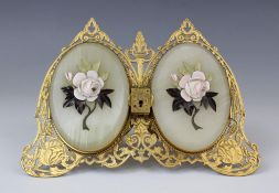 A gilt brass twin portrait picture frame, 19th century, the pierced twin arched easel frame