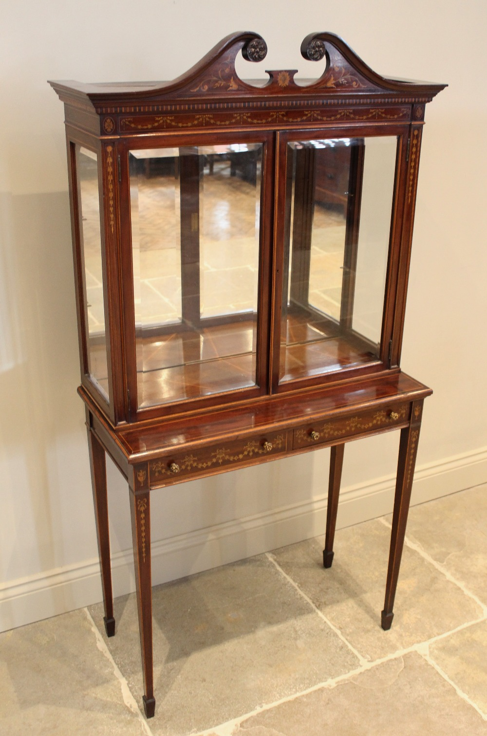 An Edwardian Sheraton revival mahogany display cabinet, by 'Old Time Furnishing Co, Westminster',