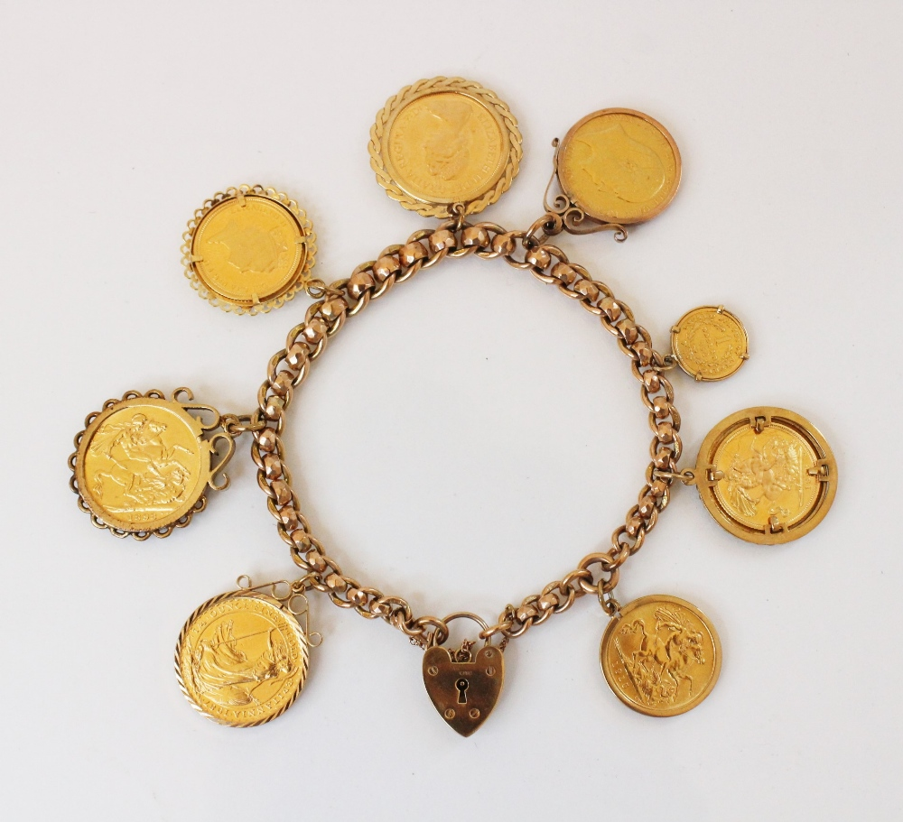 A 9ct gold curb link charm bracelet with a heart-shaped padlock fastener, 20cm long, suspending an