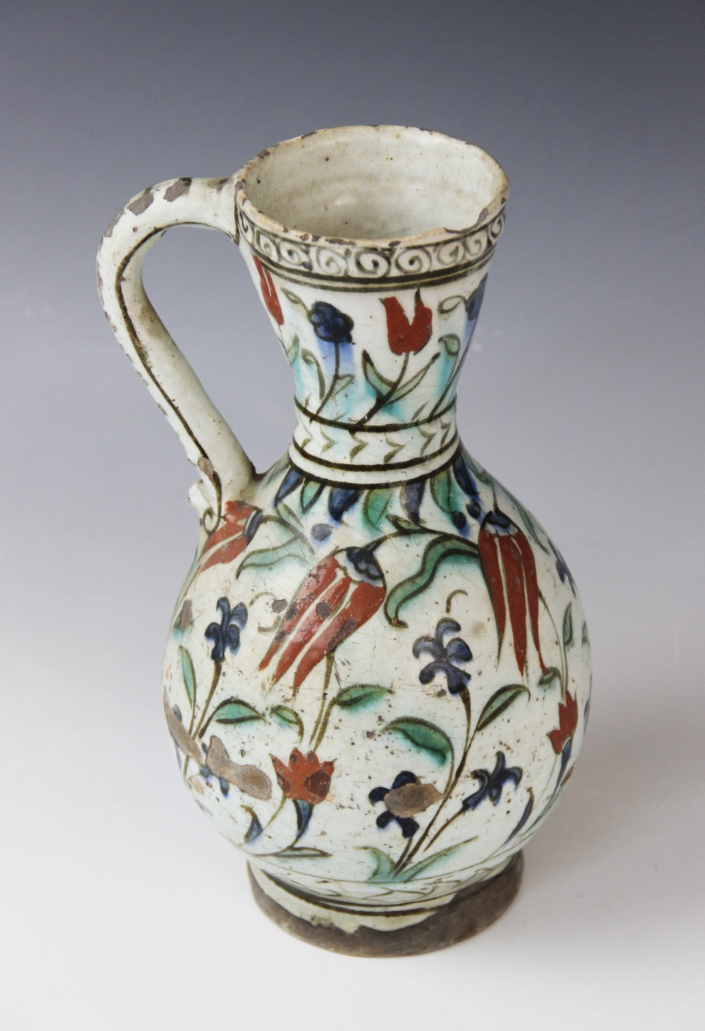 An Ottoman Empire Turkish polychrome pottery jug, of pear shape with attached handle and flared - Image 7 of 9