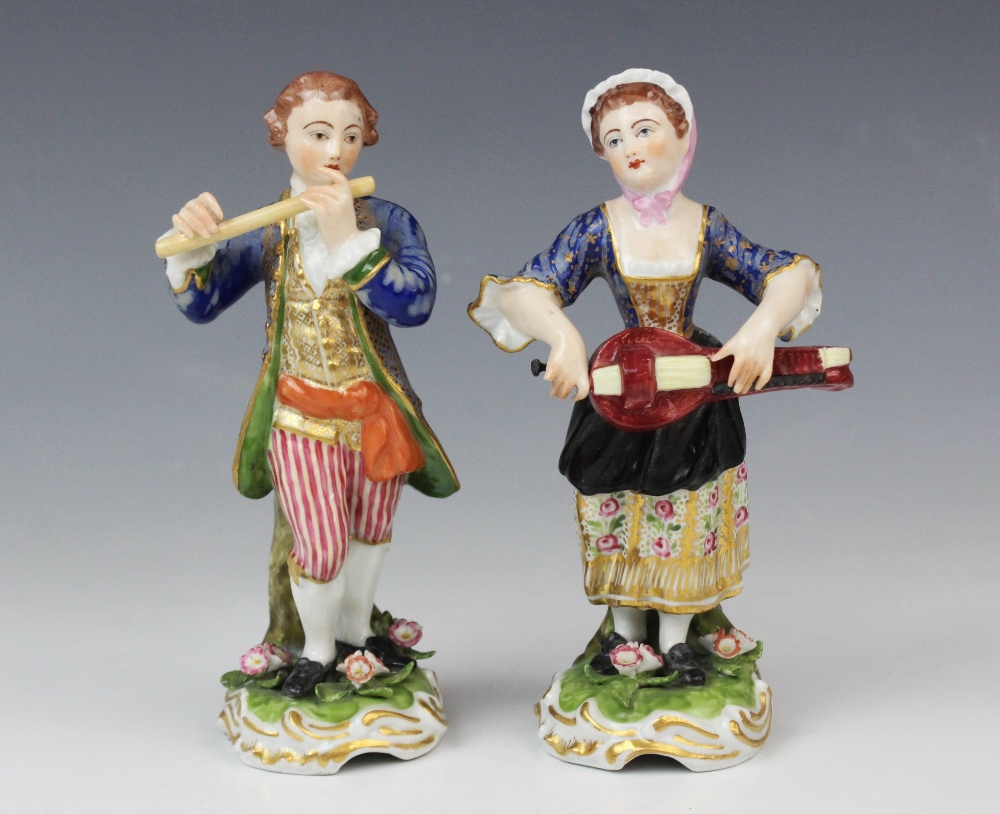 A pair of 18th century Derby musician figures, one modelled as a flautist, the other as a lutist,