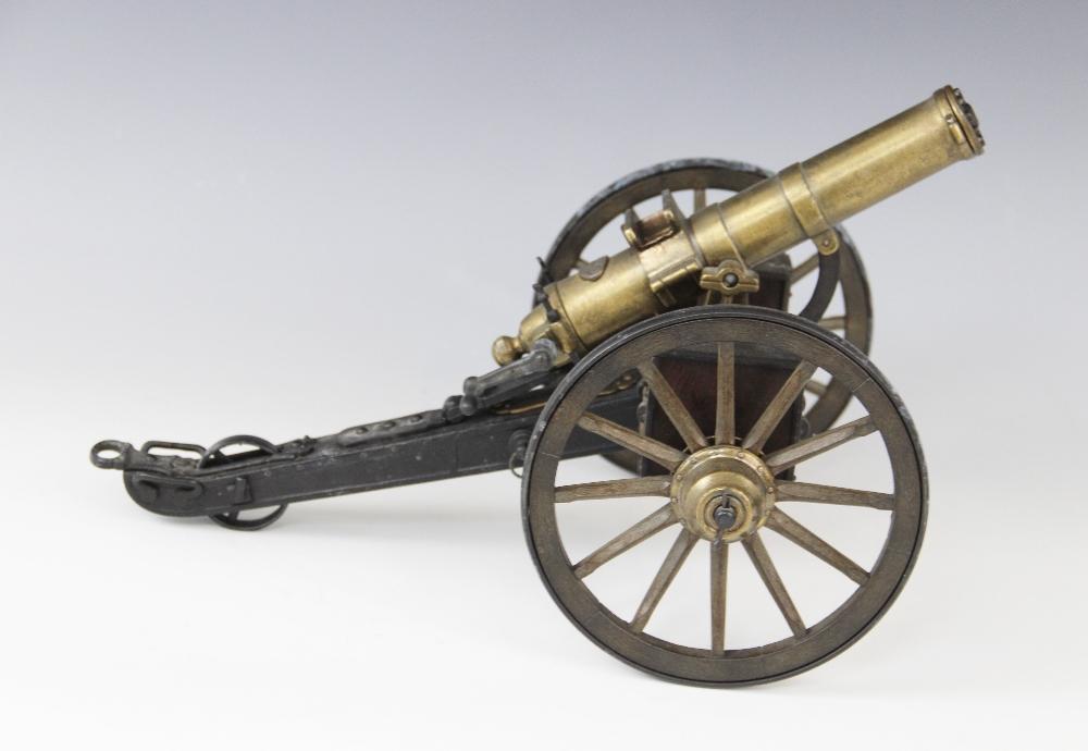 A desktop model of a Gatling field gun, the turned brass barrel set to a tilt mechanism on painted - Image 2 of 2
