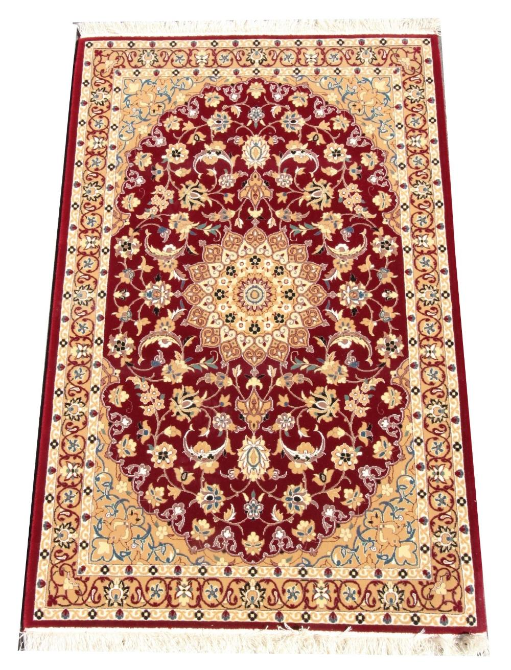 A fine woven thick pile rug, the rich red ground with lozenge Shabas medallion design, 162cm x 100cm