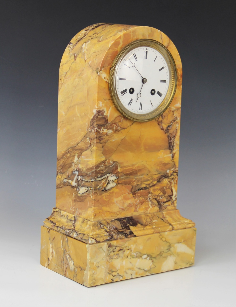 A late 19th century crema Valencia marble mantel clock, the domed case housing the 11cm white