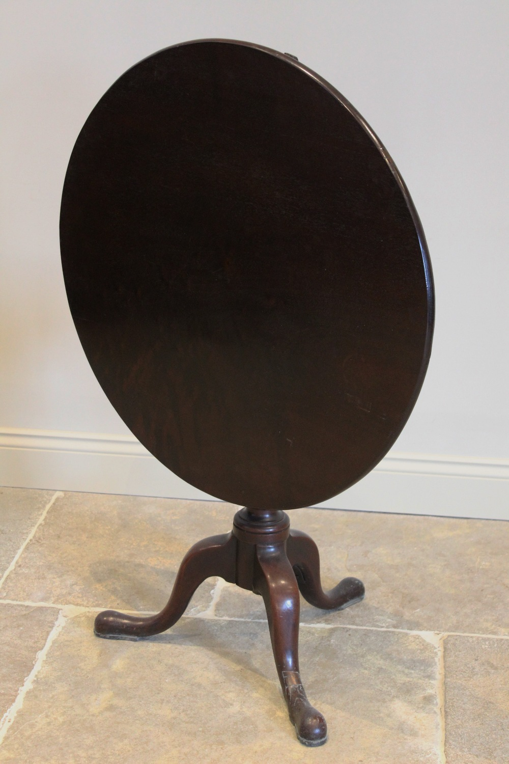 A George III mahogany tripod table, the circular tilt top raised upon a ring turned baluster - Image 2 of 3