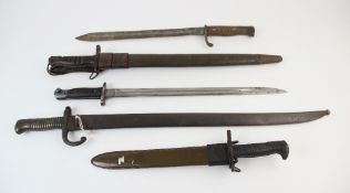 A collection of bayonets, to include a World War I period German issue rifle bayonet, probably by