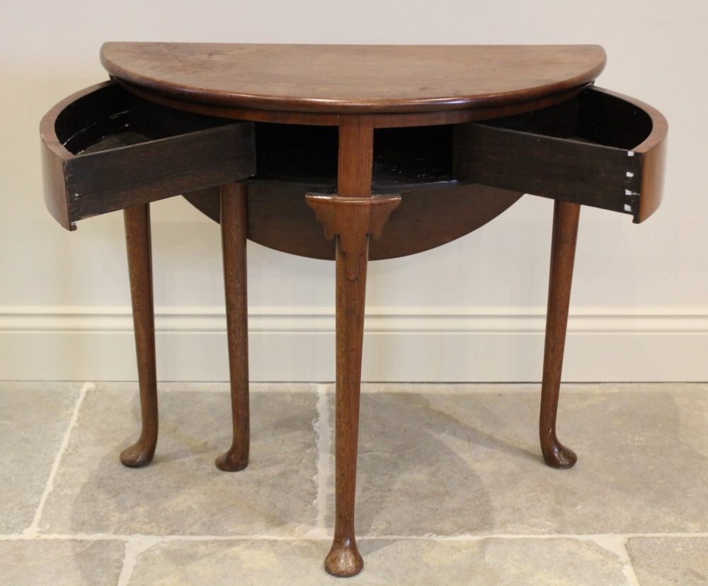 A mid 18th century mahogany folding tea table, the demi-lune folding top above two hinged drawers, - Image 2 of 2