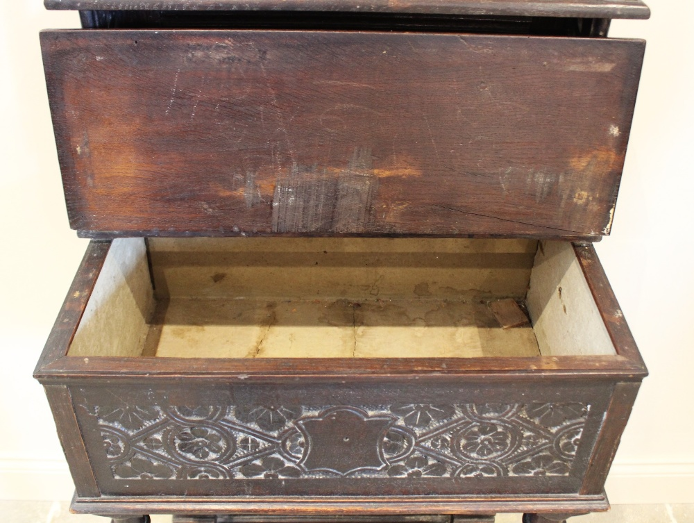 A 17th century and later carved oak hall stand, the raised back upon an early hinged bible box, - Image 2 of 2