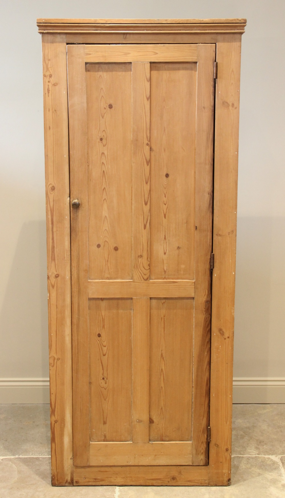 A Victorian pine kitchen cupboard, the single quatre panelled door opening to six fixed shelves,