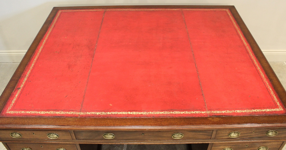An early 20th century mahogany partners desk, the rectangular moulded top inset with a gilt tooled - Image 3 of 3