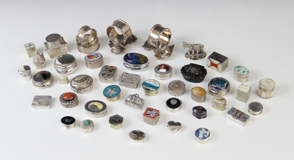 A selection of pill boxes, novelty containers and table accessories, to include a continental silver