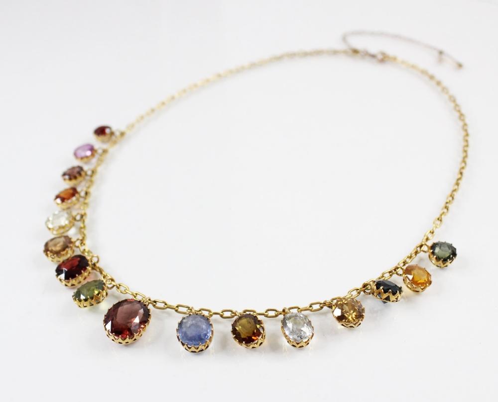 An Edwardian multi gem set fringe necklace, comprising sixteen graduated oval gemstones, including - Image 2 of 6