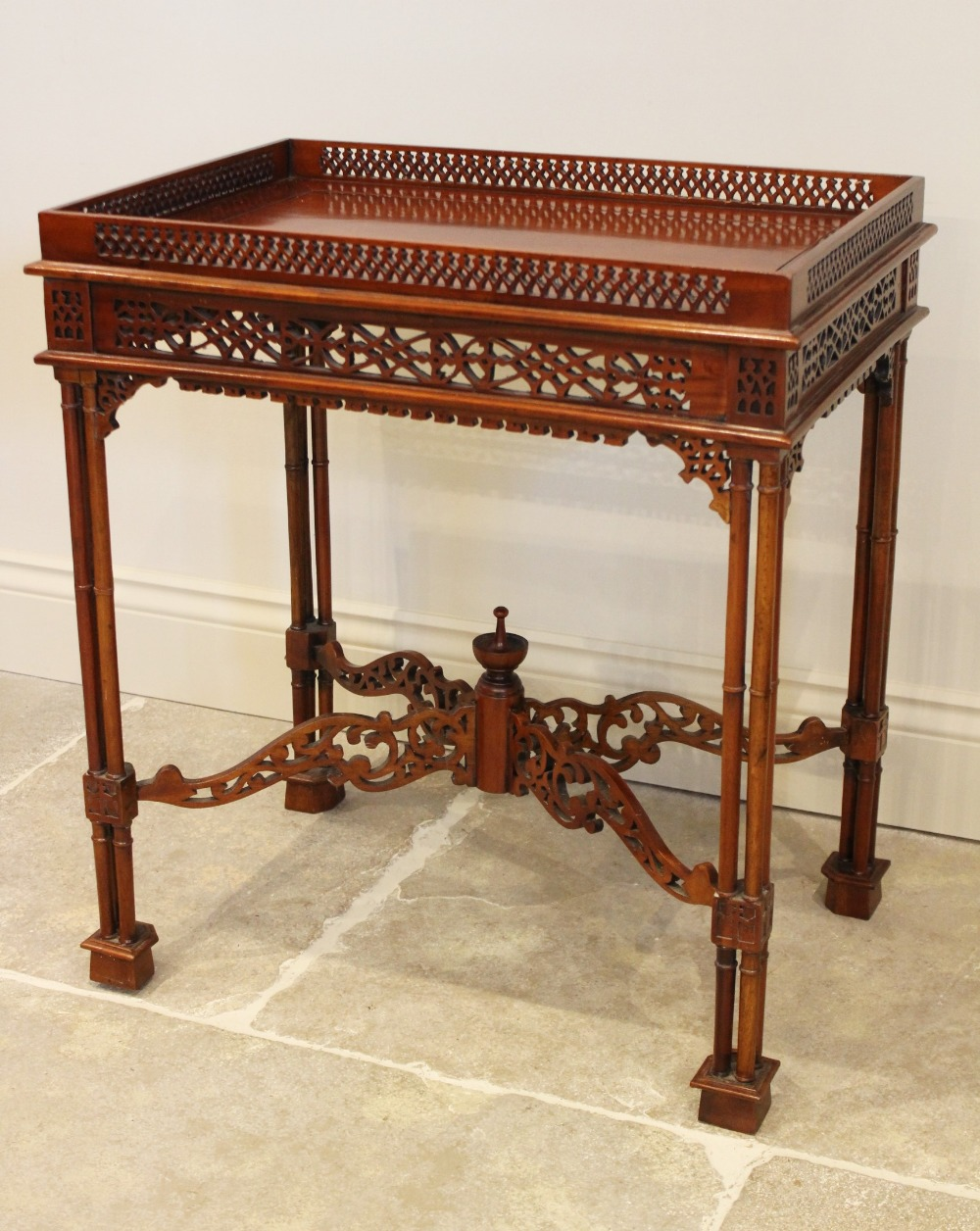 A Chinese Chippendale style mahogany silver table, late 20th century, the rectangular top with a