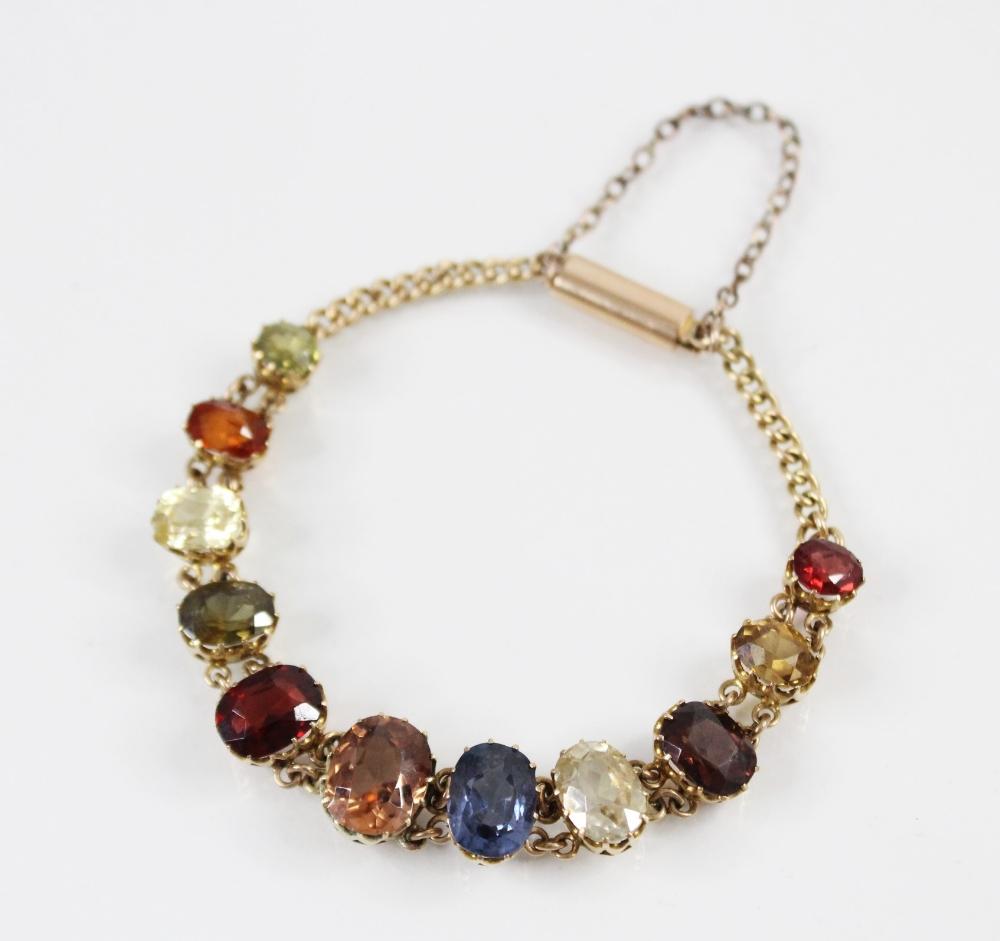 An Edwardian multi gem set fringe necklace, comprising sixteen graduated oval gemstones, including - Image 6 of 6