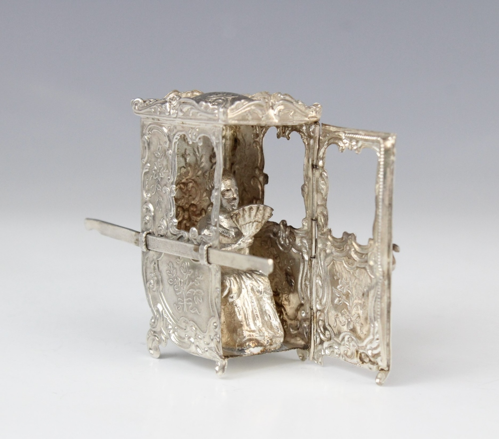A silver model of a sedan chair, decorated in rococo style with repoussé scrolls and flowers, the - Image 3 of 3