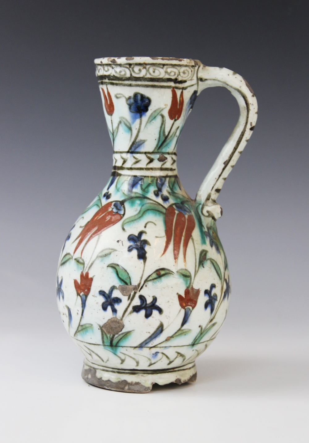 An Ottoman Empire Turkish polychrome pottery jug, of pear shape with attached handle and flared - Image 2 of 9