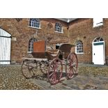 A 19th/20th century horse drawn carriage/trap, the 7ft long cart supporting four iron wheels, the