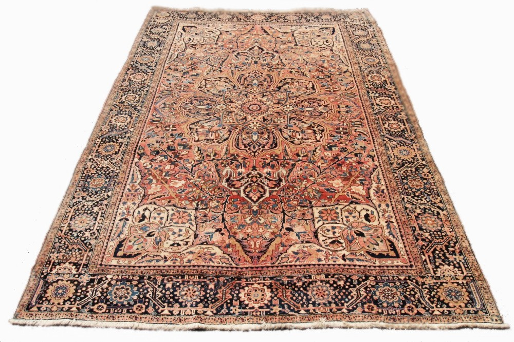 A large Persian Tabriz wool carpet, the central floral medallion engulfed with formal foliate