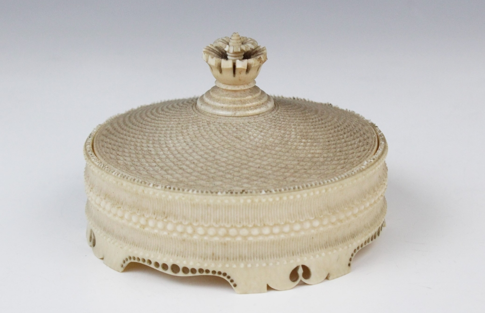 A turned ivory box and cover, Dieppe (19th century), the finely ribbed and beaded body on pierced