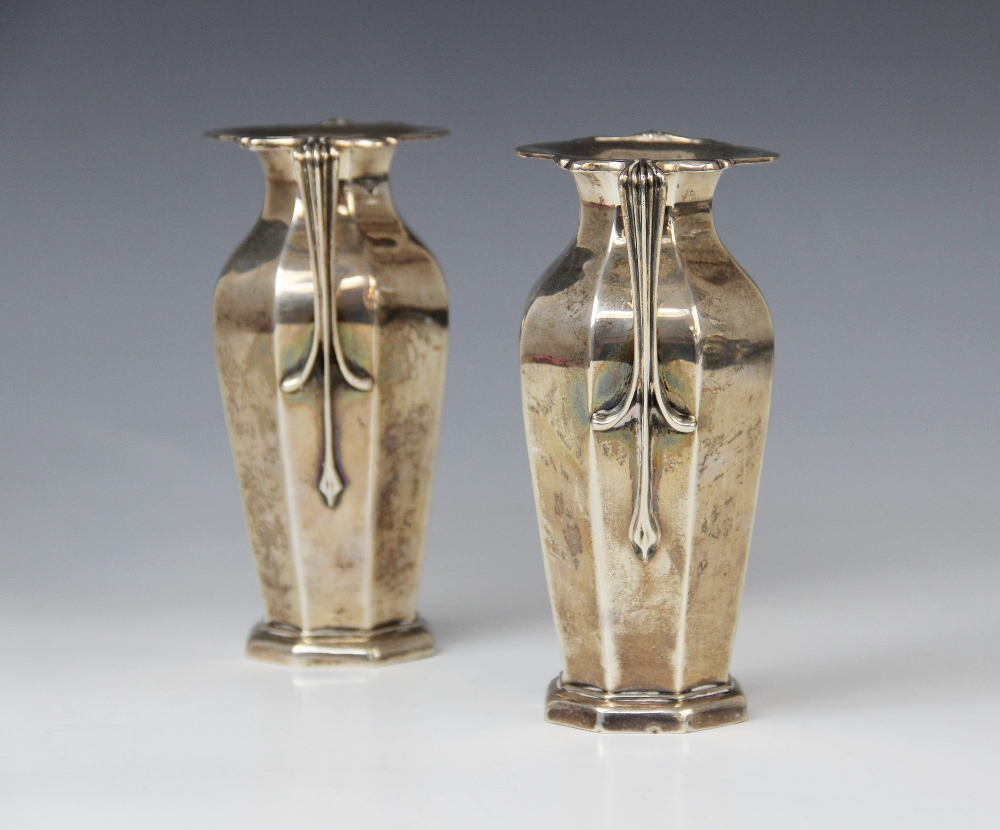 A pair of Edwardian silver twin-handled vases by Goldsmiths & Silversmiths Company, London 1909, - Image 2 of 11