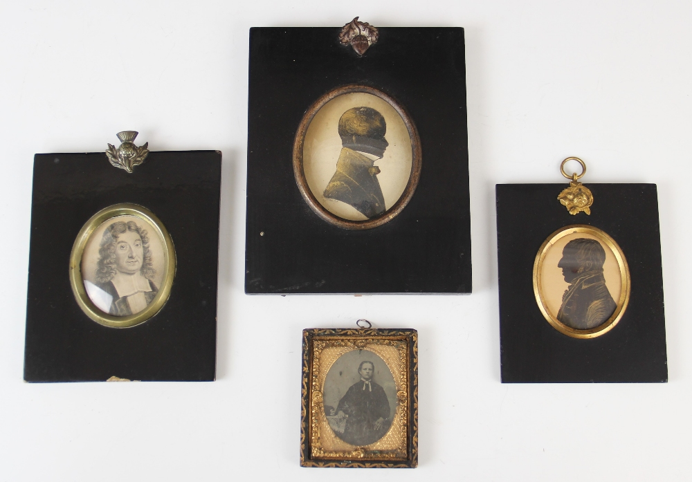 A framed silhouette miniature, 19th century, depicting William Freeman of Ely facing dexter, with