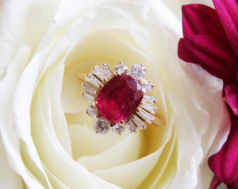 A ruby and diamond cluster ring, the central rectangular cushion cut ruby (measuring 8.2 x 6.6 x 4. - Image 4 of 10