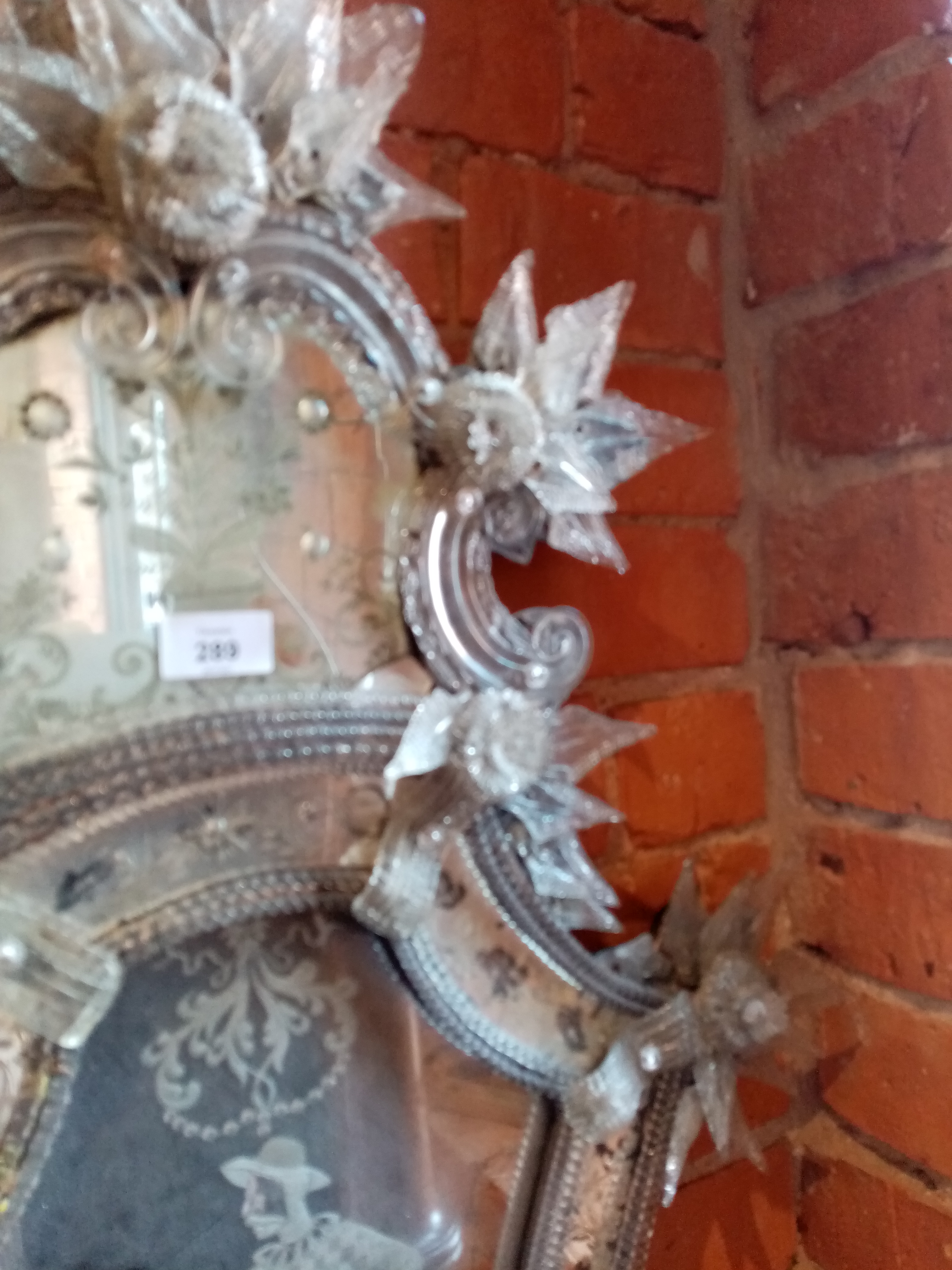 A 19th century Venetian glass wall mirror, the shield shaped mirrored plate centred with an etched - Image 5 of 6