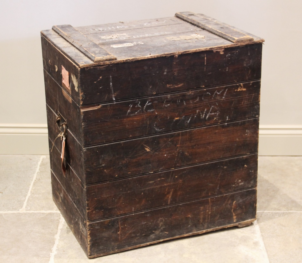 An early 20th century stained pine slatted trunk, applied with iron side swing handles, and hand