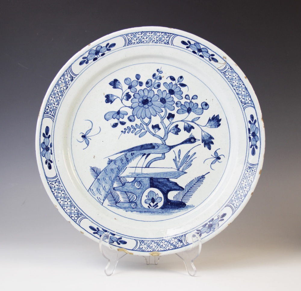 A Delft ware charger, 18th century, the tin glazed earthenware charger of circular form, the central