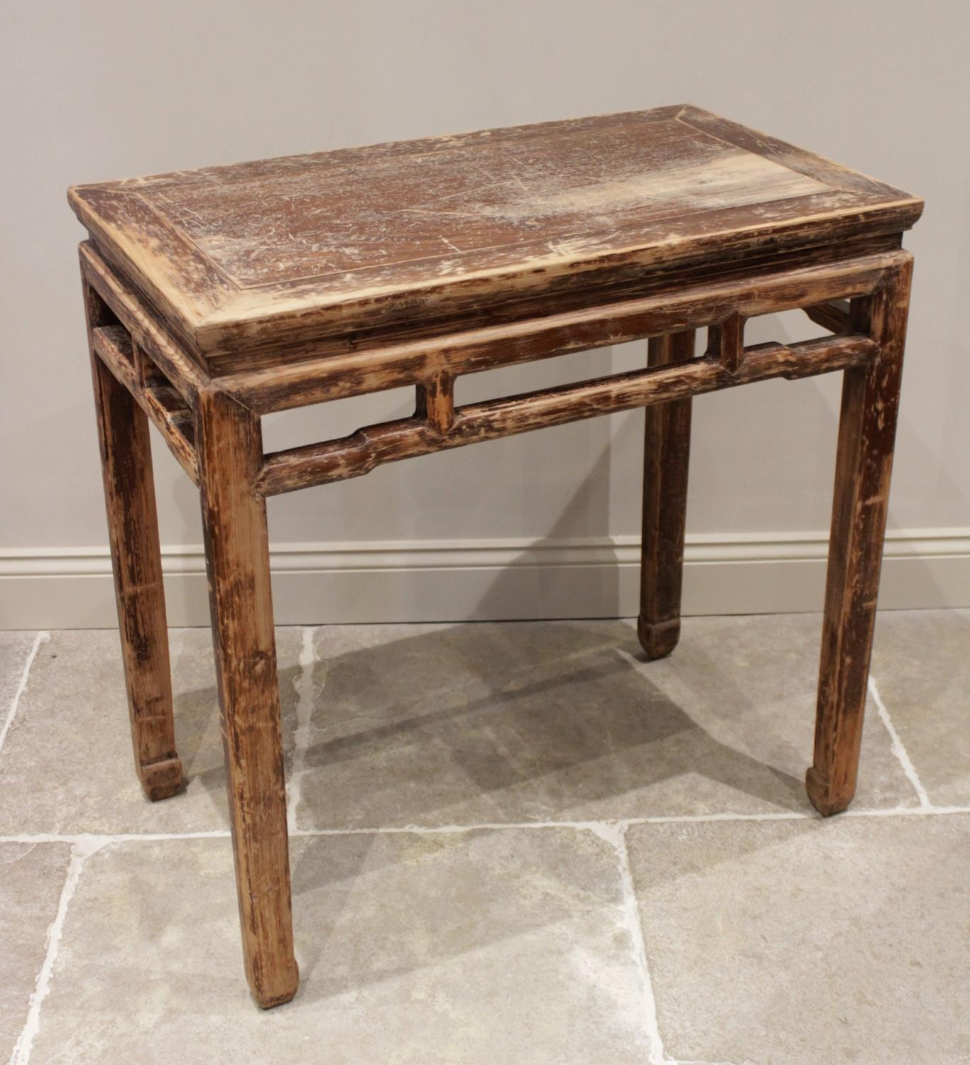 A Chinese stained wood altar table, 20th century, the cleated rectangular top above an inverted