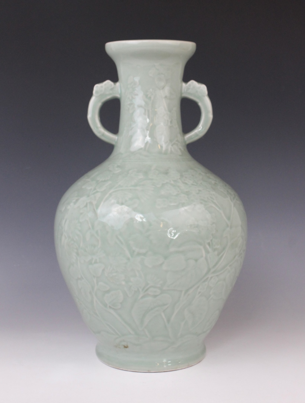 A Chinese Longquan celadon glazed vase, 20th century, the arrow-head type shaped twin handled vase