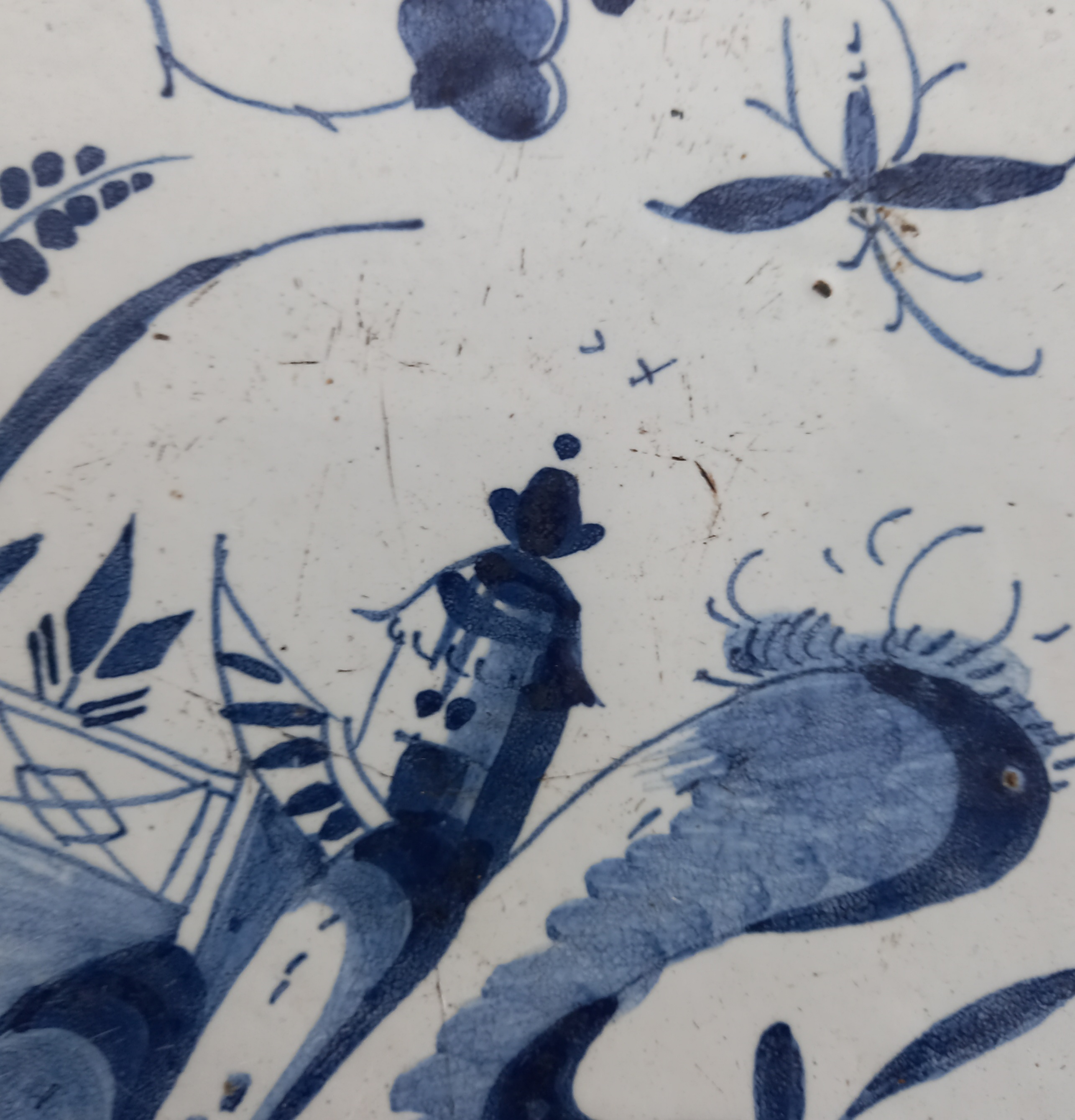 A Delft ware charger, 18th century, the tin glazed earthenware charger of circular form, the central - Image 5 of 6