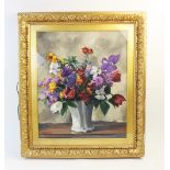R. Bielle (French school, 20th century), A floral still life in a white vase, Oil on board, Signed