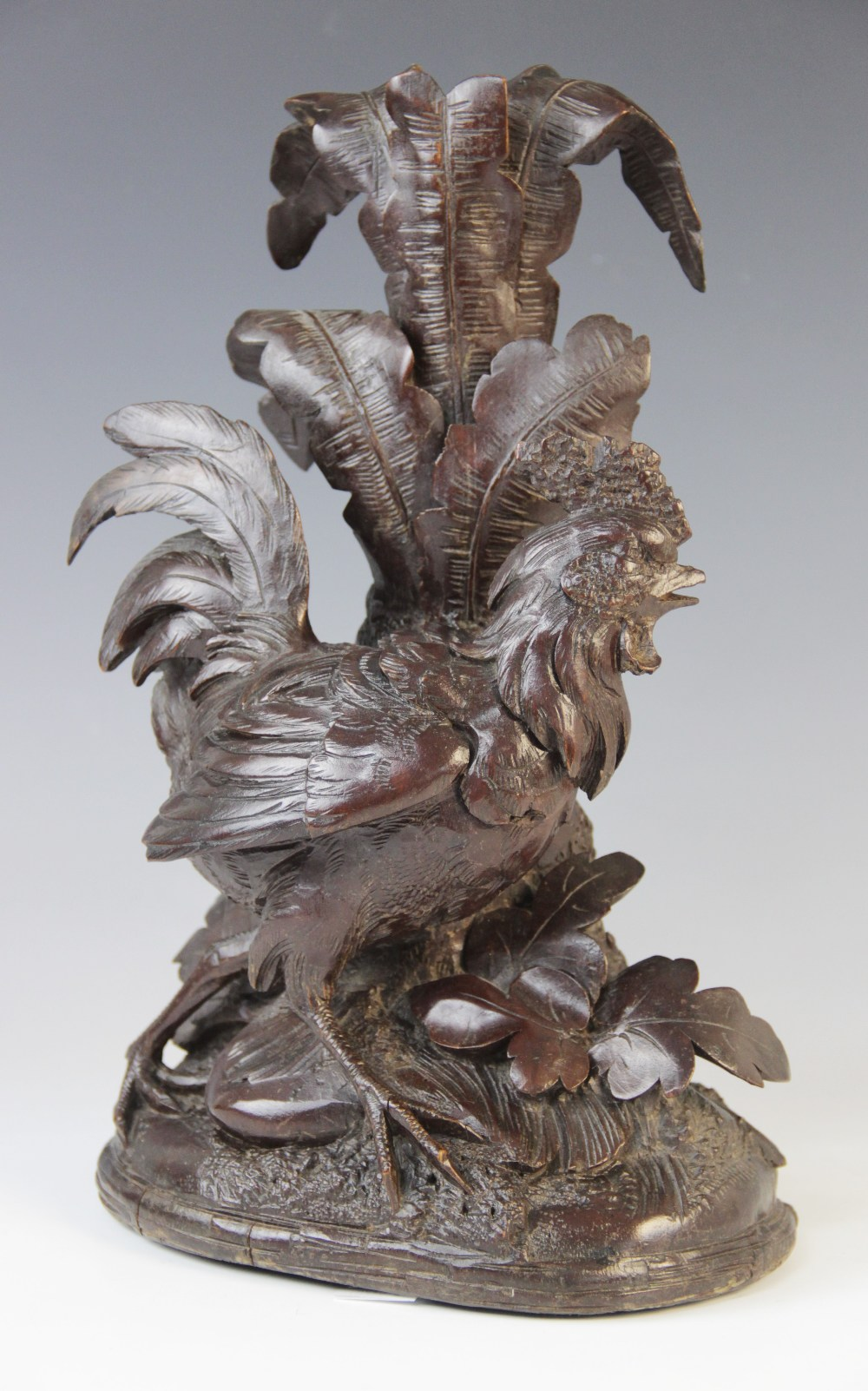 A Black Forest wood carving, probably 20th century, modelled as a cockerel strutting across a - Image 2 of 2