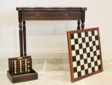 A George III style mahogany games table, late 20th century, the serpentine folding top opening to