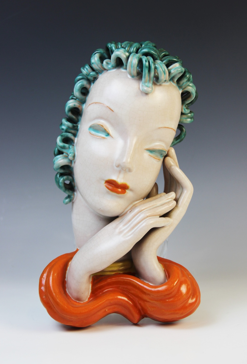 An Art Deco Goldscheider wall mask, early 20th century, modelled as a lady with blue curled hair and