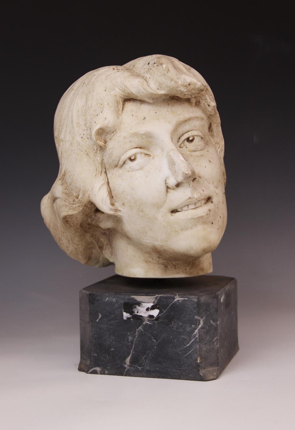 An Art Deco marble sculpture of a female head, early 20th century, set above a grey marble plinth, - Image 2 of 5