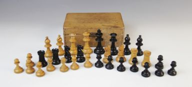 A German Schachklub chess set, early 20th century, of typical form with boxwood and ebony pieces, in