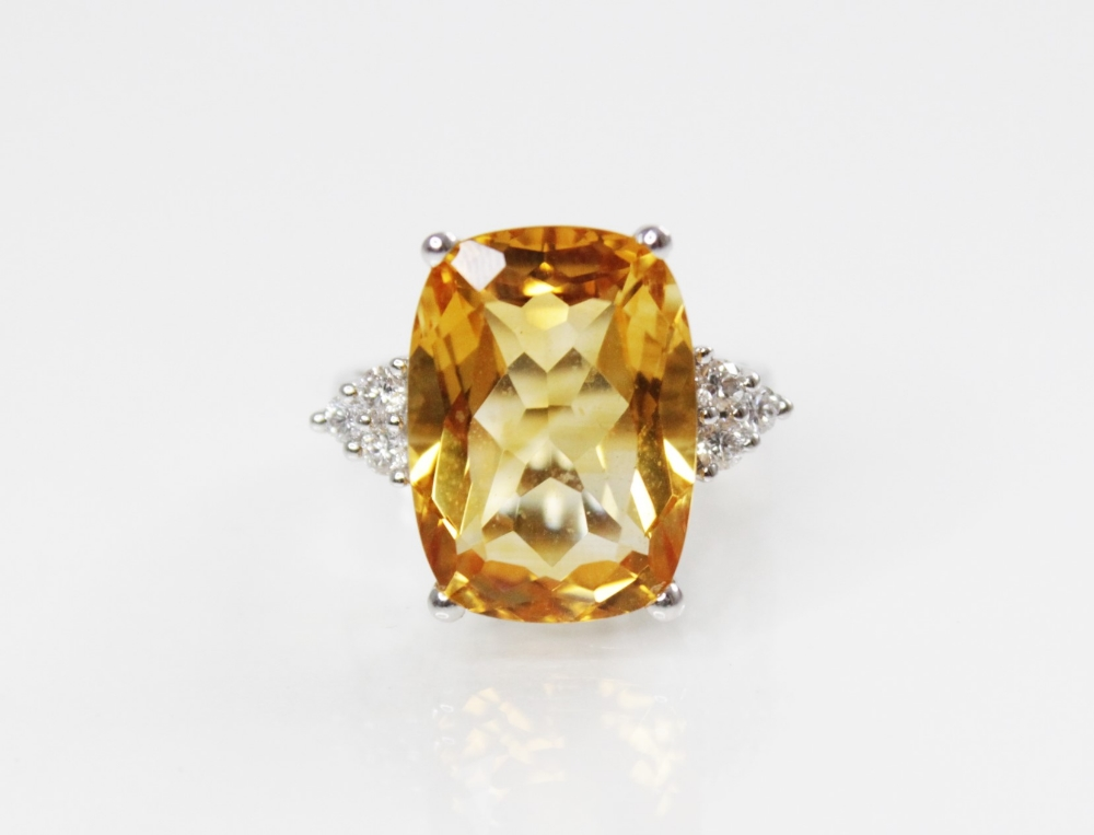 A citrine and diamond 18ct gold ring, the central rectangular mixed cut citrine (measuring 18mm L