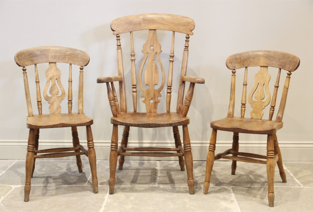 A Victorian elm and beech wood Windsor farmhouse elbow chair, the pierced splat above a shaped seat,