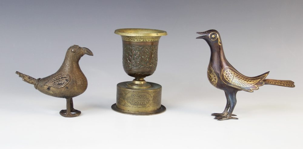 Three Eastern metalwork objects of virtue, comprising; a Persian chalice, 14cm high, an Indian
