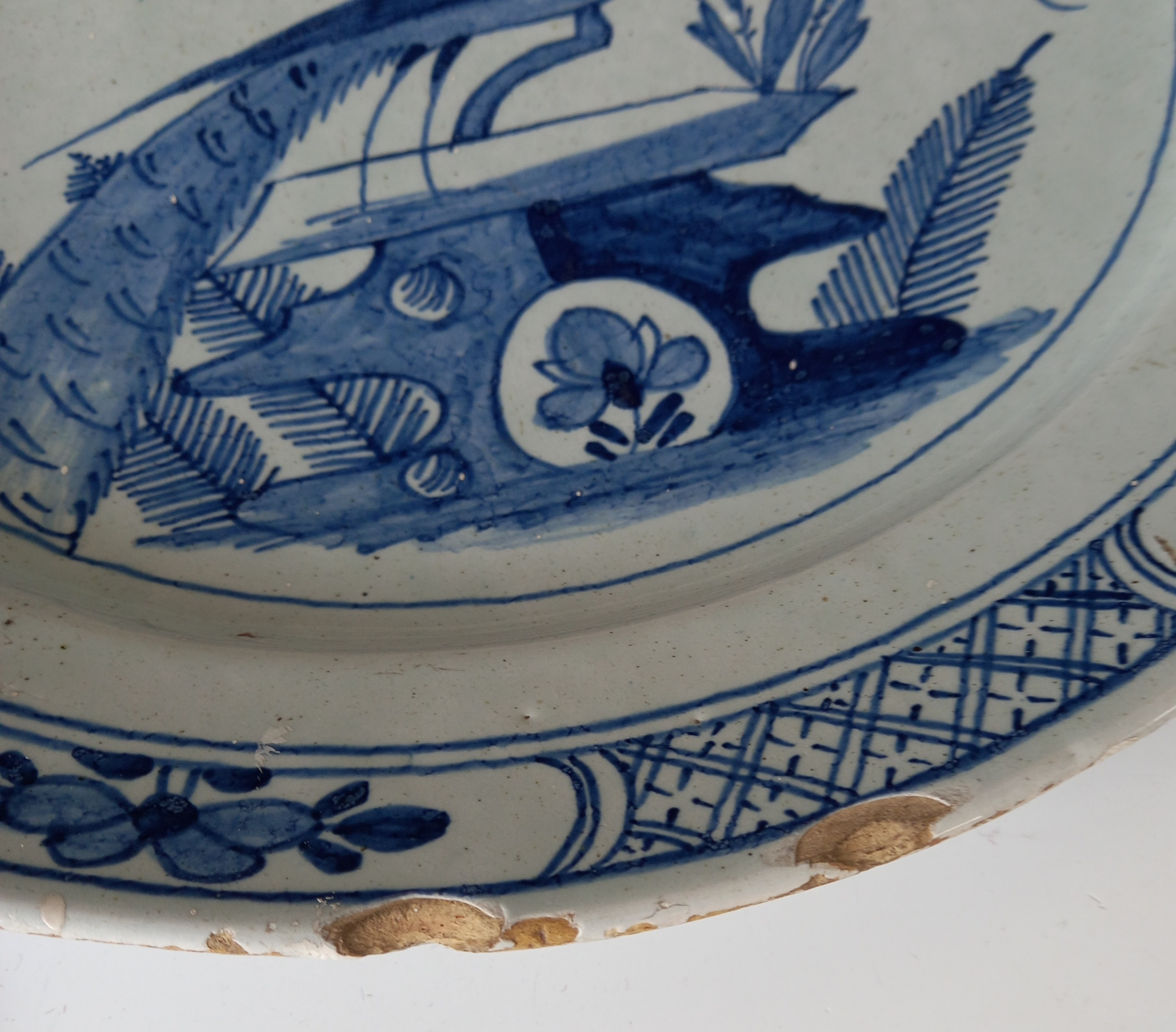 A Delft ware charger, 18th century, the tin glazed earthenware charger of circular form, the central - Image 3 of 5