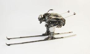 James Corbett (Australian, contemporary), 'Skier', a sculpture of a downhill skier realistically