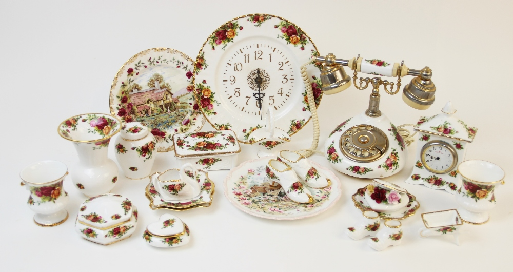 A Royal Albert 'Old Country Roses' vintage style telephone by Astral Telecom, with a collection