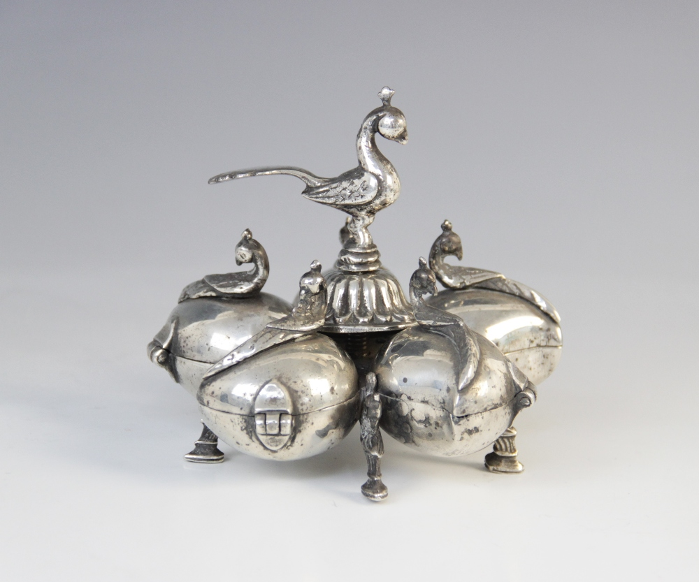 An Indian white metal spice box, comprising five petal form compartments with hinged covers and