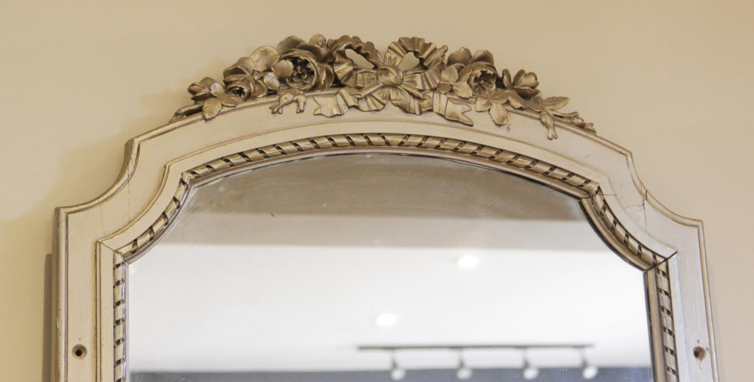 A large painted hardwood pier mirror, late 20th century, the frame surmounted with a foliate crest