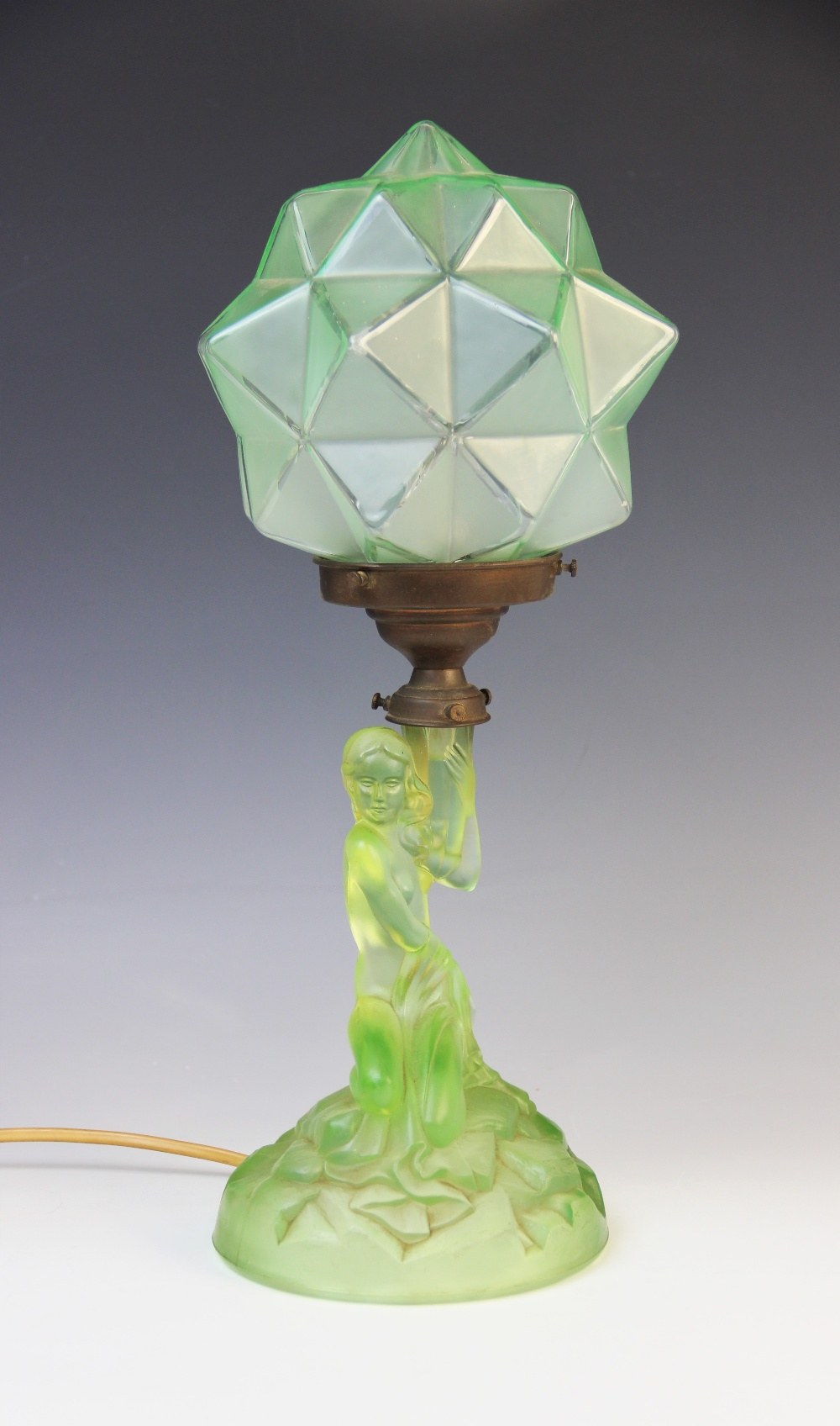 An Art Deco green glass table lamp by Walther & Sohne, early 20th century, modelled as a nymph on