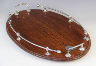 An early 20th century mahogany gallery drinks tray, of oval form with white metal handles, with