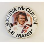 A vintage circular Steve McQueen 'Le Mans' enamel sign, mid 20th century, made to promote the